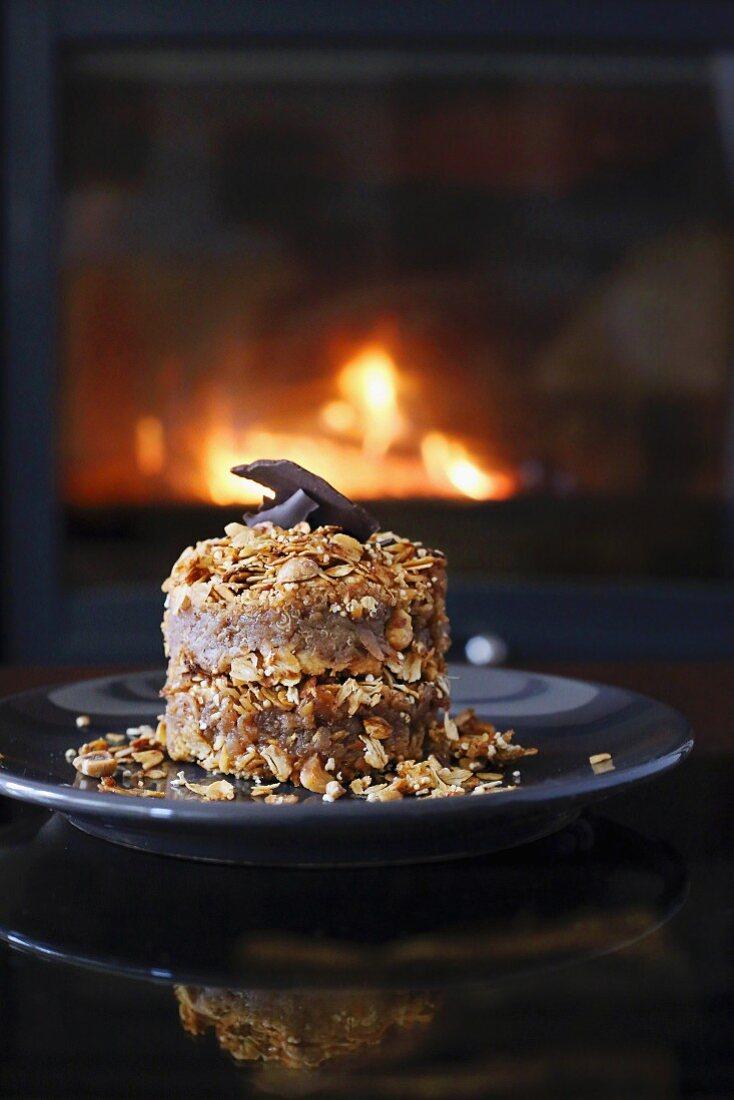 An oats and apple dessert in front of an open fire