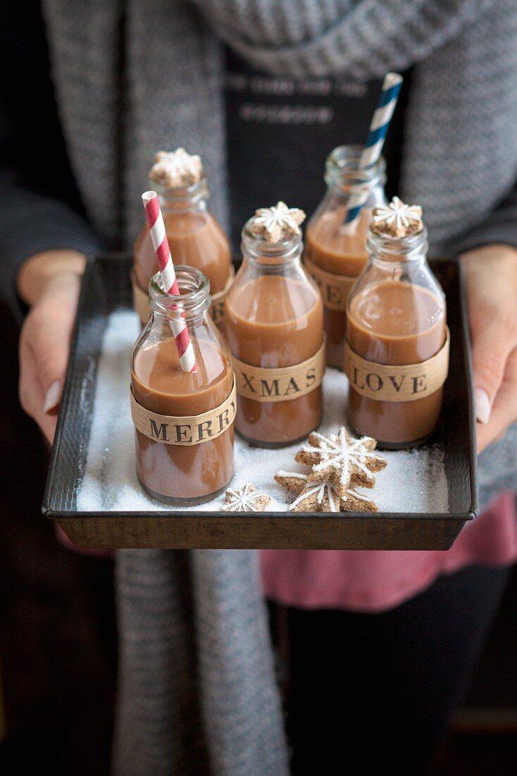 A woman serving praline liqueur for Christmas