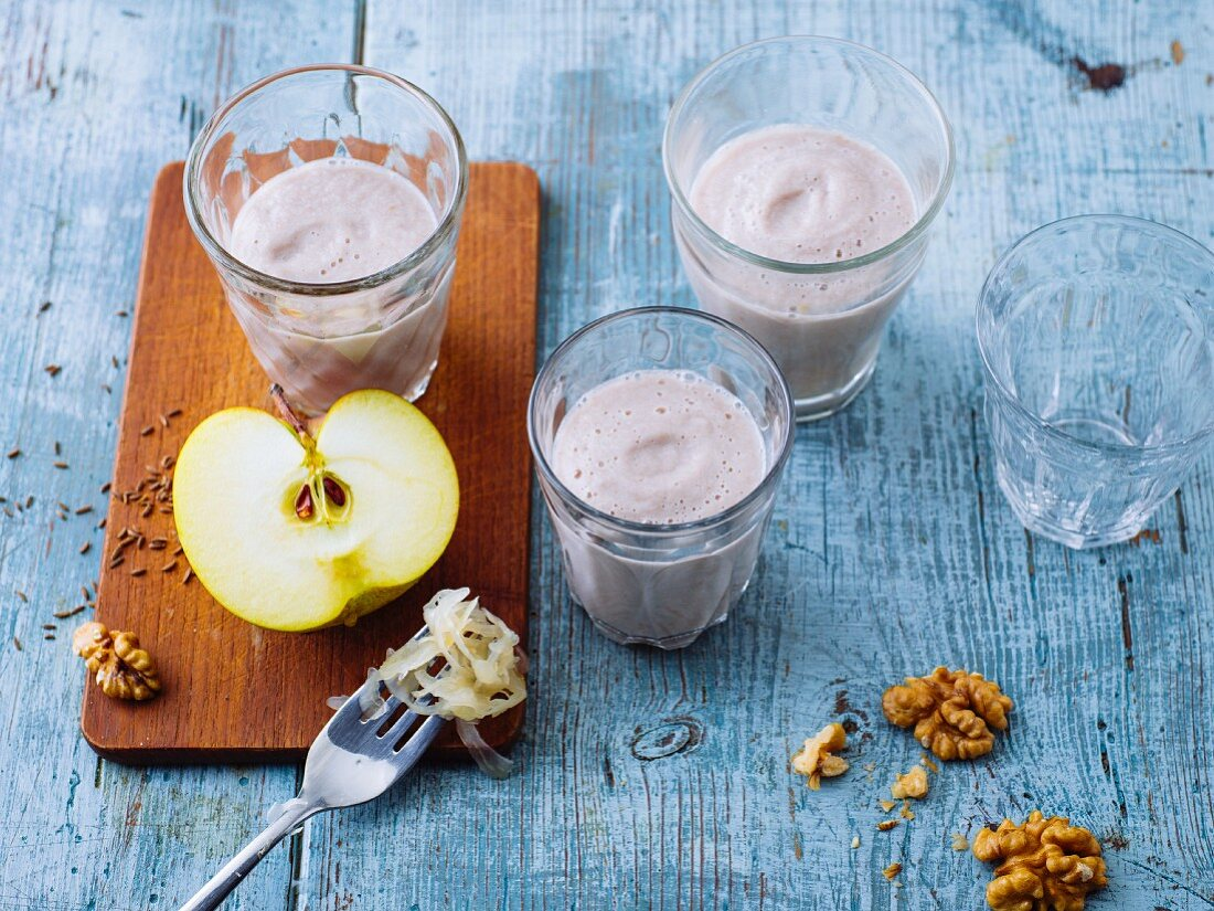 Apple and sauerkraut smoothies with acacia honey and walnuts