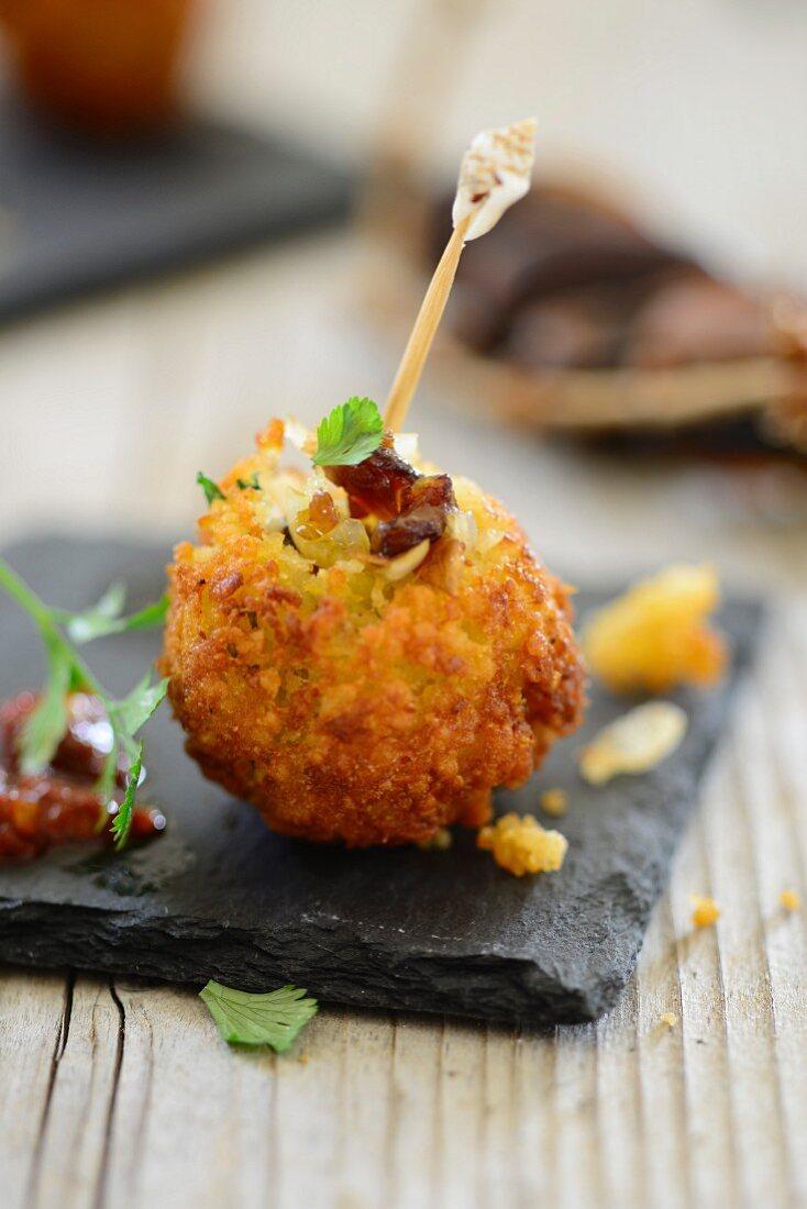 A baked potato and bulgur ball