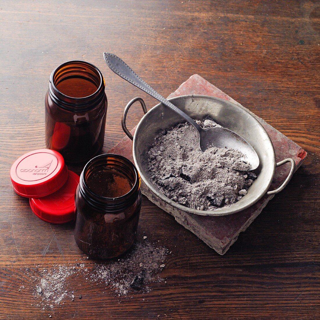 Vine ash à la Hildegard von Bingen being poured into bottles (vine ash dental wine)