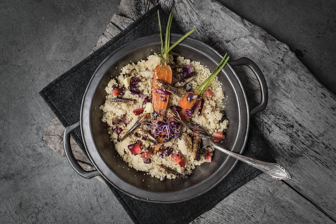 Strawberry risotto with spring vegetables and grasshoppers