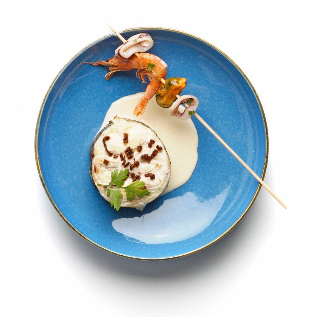 Eel steak and seafood skewer with garlic sauce