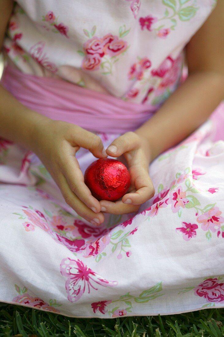 Girl holding an Easter chocolate egg