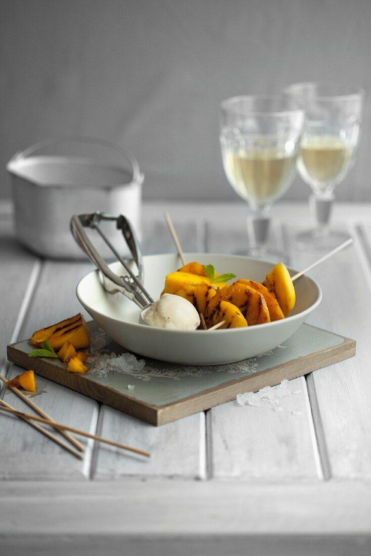Caramelised mango skewers with lemongrass ice cream