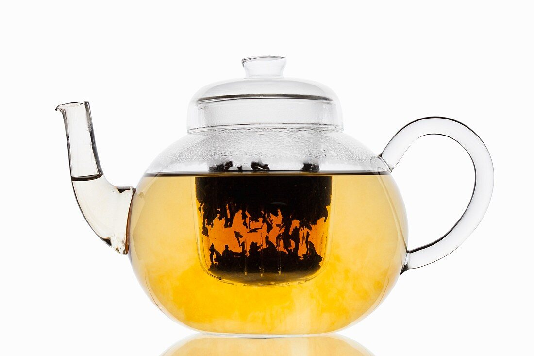 Tea in a glass teapot with a filter