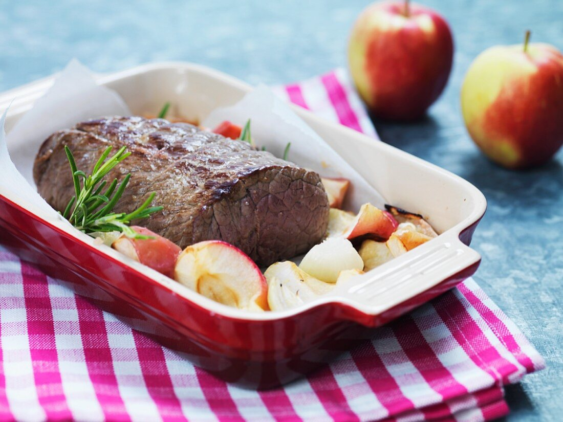 Roast beef with apple and rosemary