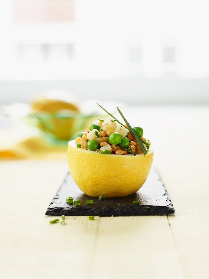 Aromatic scamorza salad served in a lemon half
