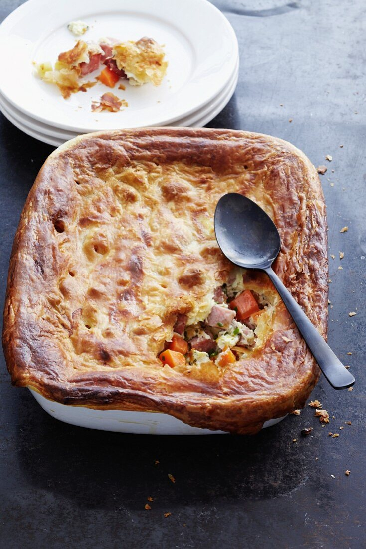 Root vegetables with gammon with a puff pastry topping