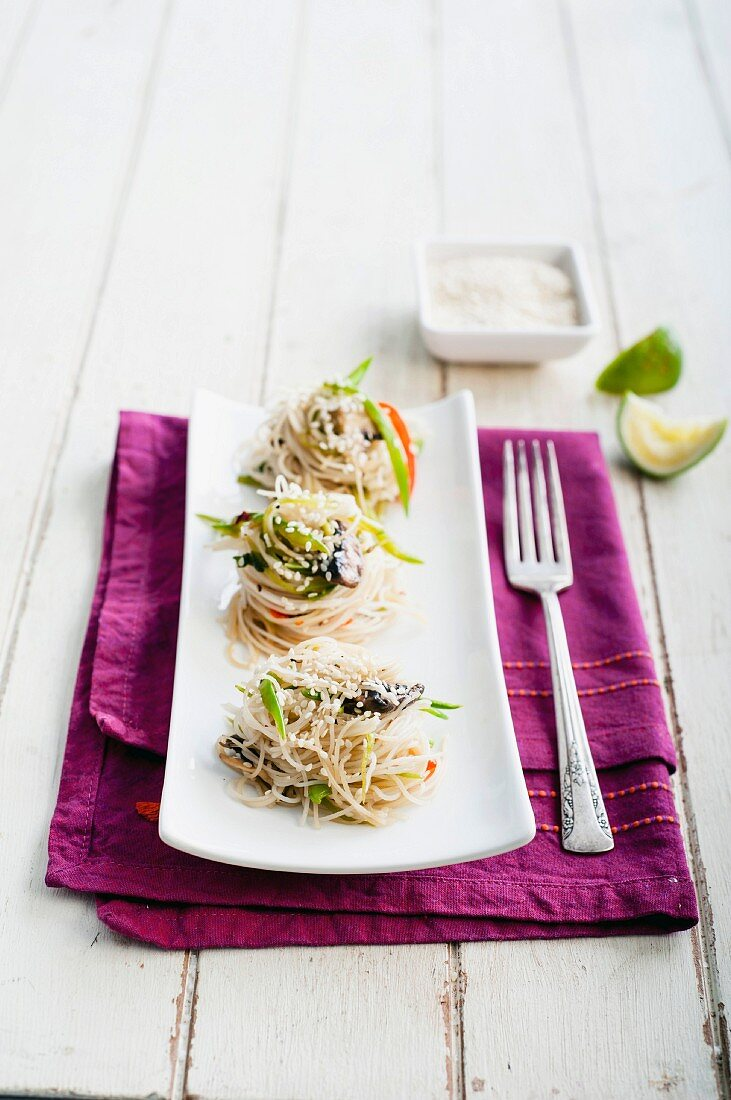 Pasta nests with mushrooms and sesame seeds