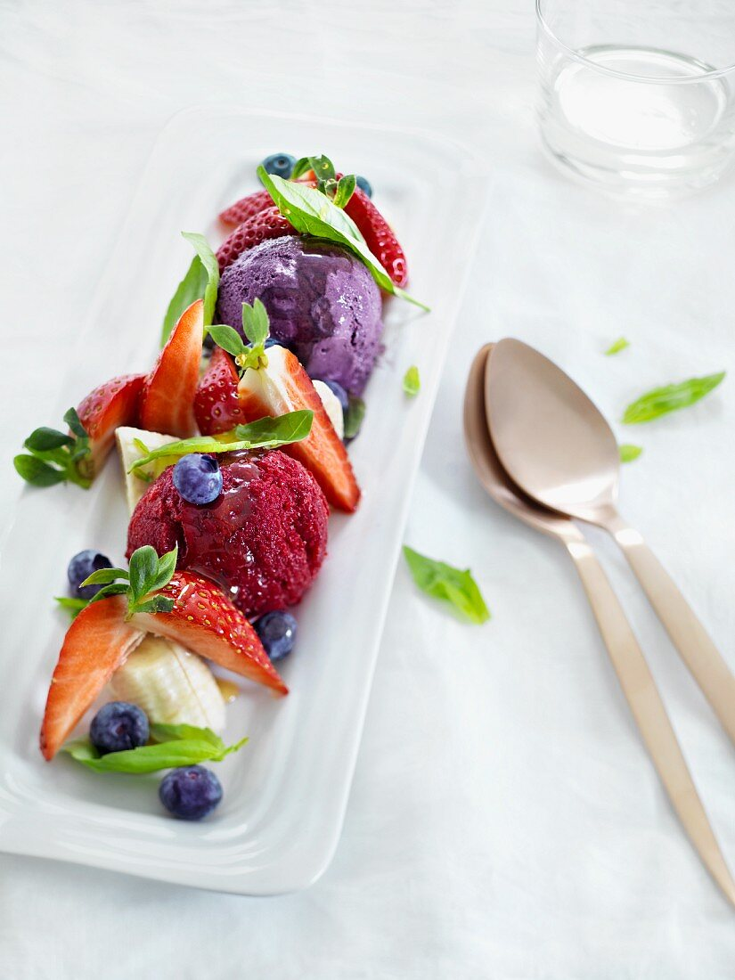 Blueberry ice cream and strawberry ice cream with fresh berries
