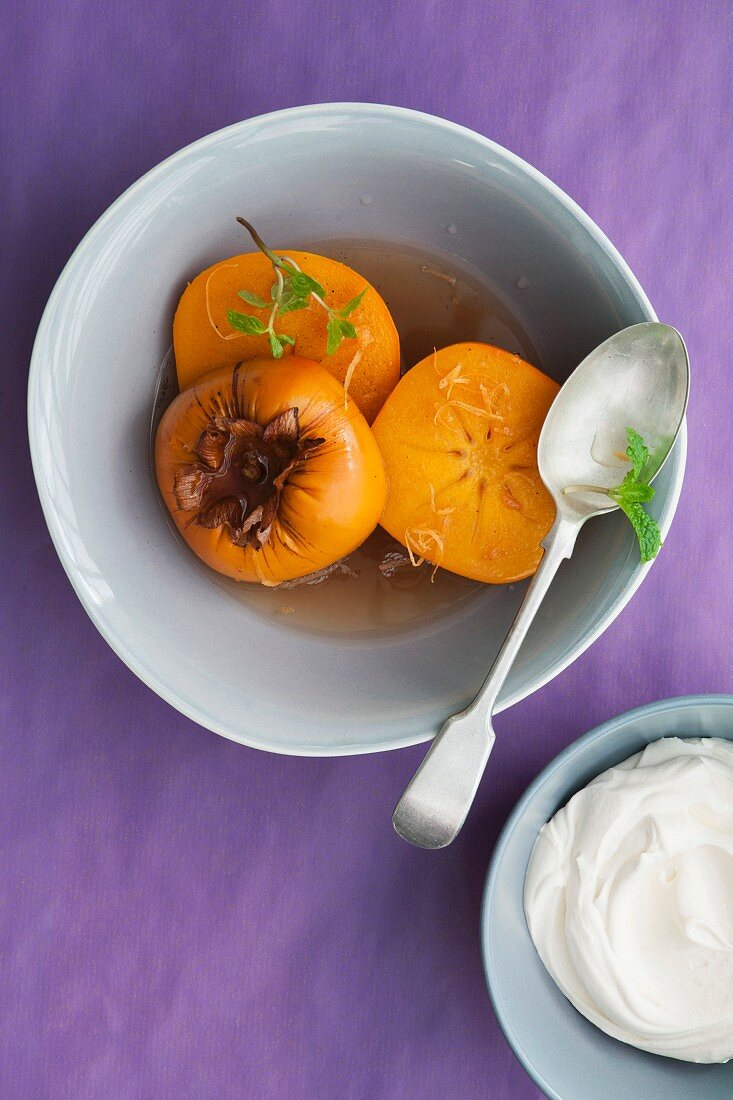 Persimmons in vanilla and grapefruit syrup with white chocolate cream