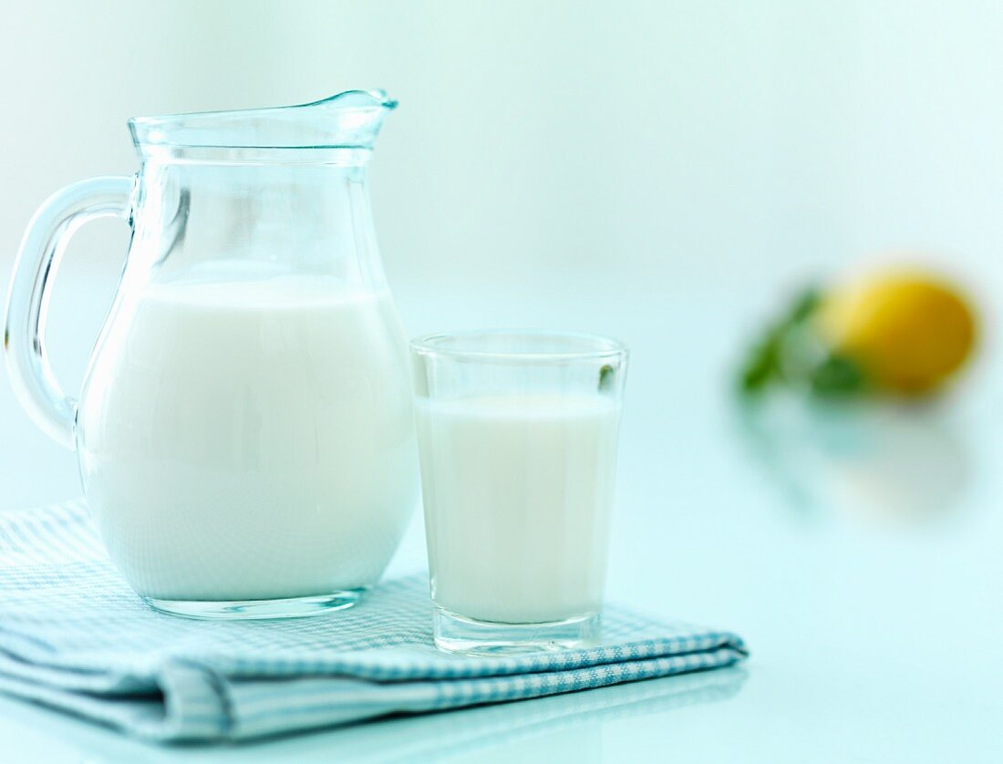 Milk in a glass and a jug