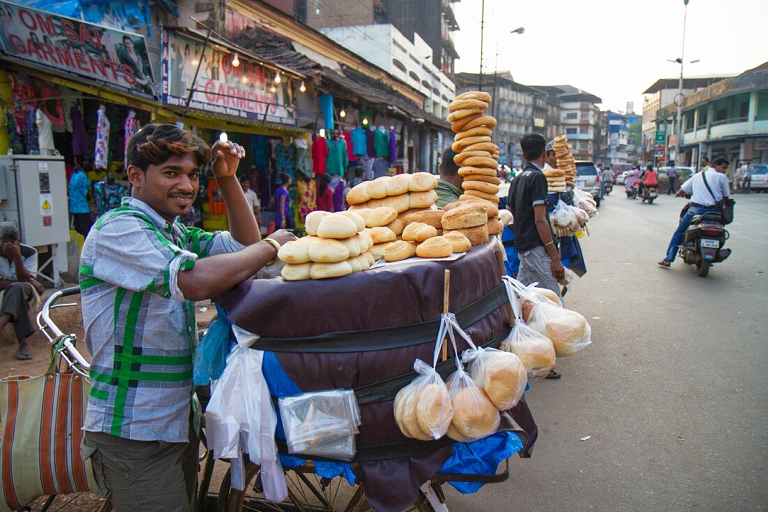 A pao bread seller at a street market in Margao, Goa, India