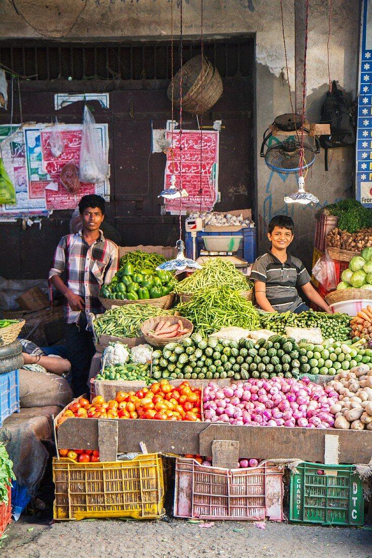 Boys at a market stall in Margao, Goa, India
