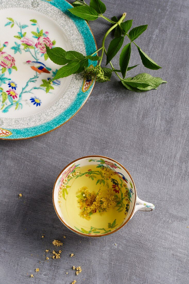 Elderflower tea in a floral-patterned cup