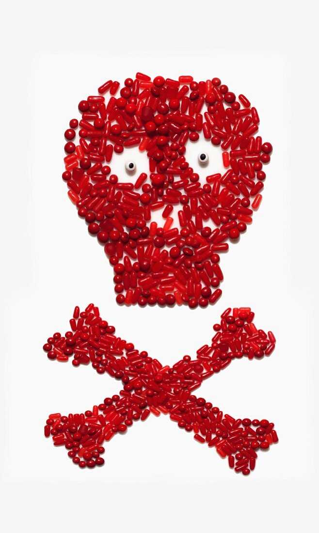 A skull and cross bones made from red bonbons