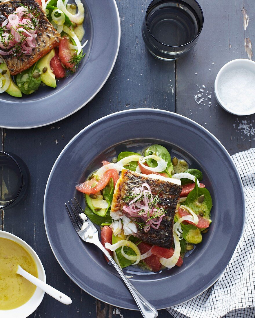 Barramundi fillet with vegetables and onions