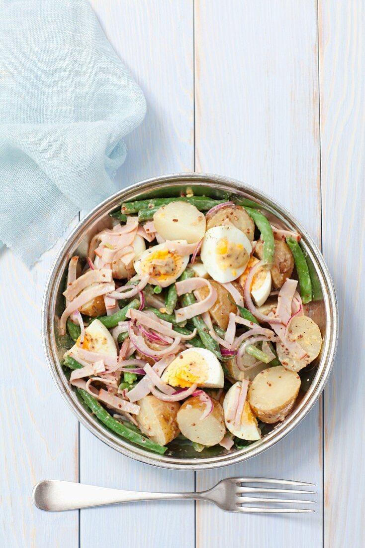 Potato salad with ham, egg, green beans and a mustard vinaigrette