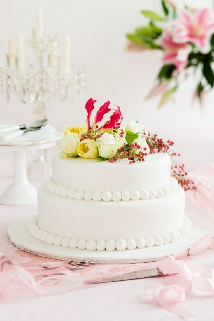 A wedding cake decorated with flowers