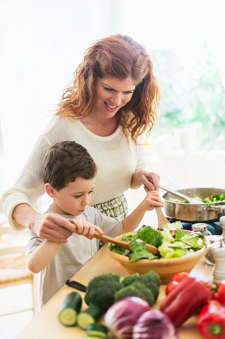 A mother and son making a salad