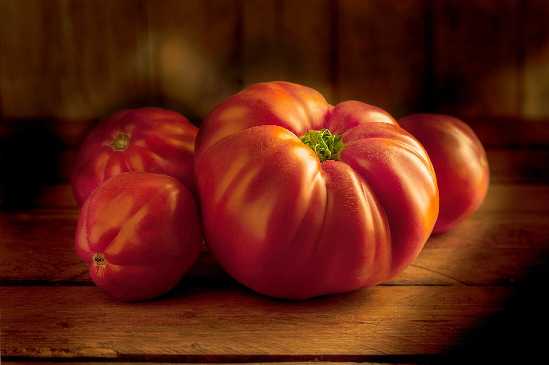 Beefsteak tomatoes on a wooden surface