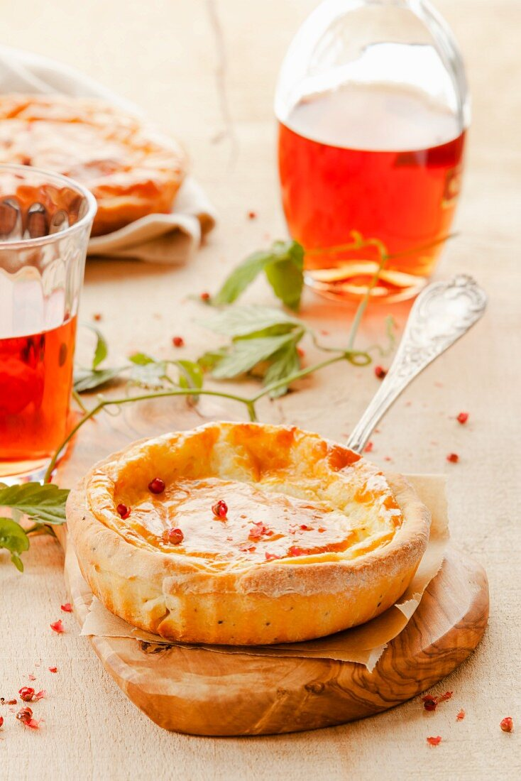 A mini cheese tart served with rosé wine