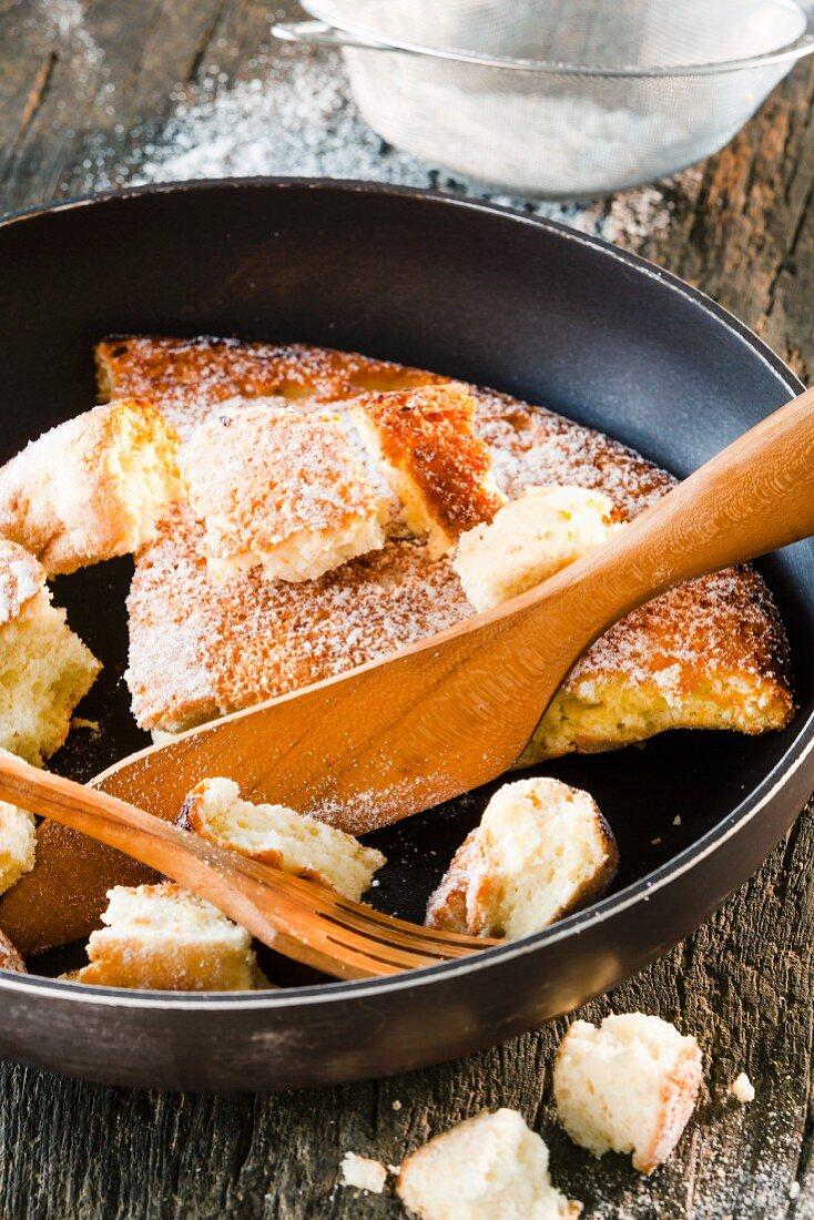 Kaiserschmarren (shredded sugared pancake from Austria) being shredded