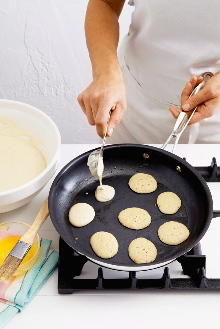 Blini batter being added to a pan