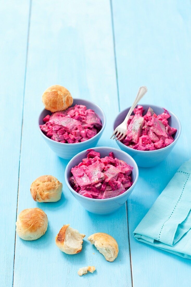 Herring salad with beetroot, egg and homemade bread rolls