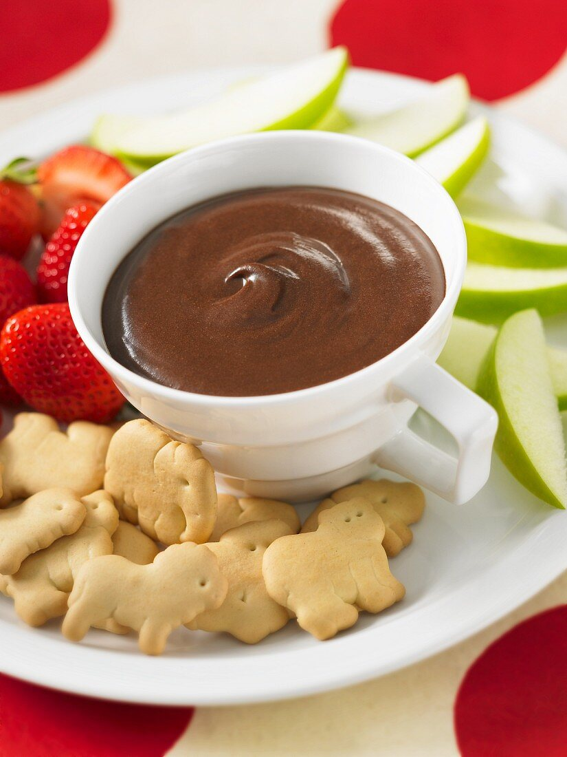 Brownie butter dip with sweet animal biscuits and fruit