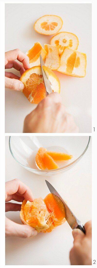 An orange being filleted