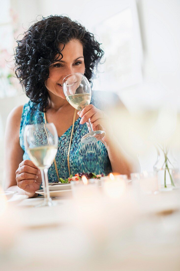 A woman tasting wine in a restaurant