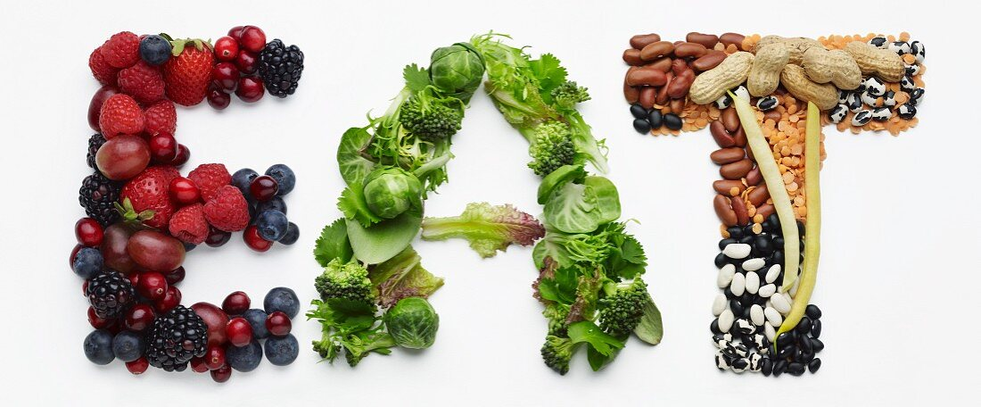 The word 'Eat' made from berries, vegetables, legumes and peanuts