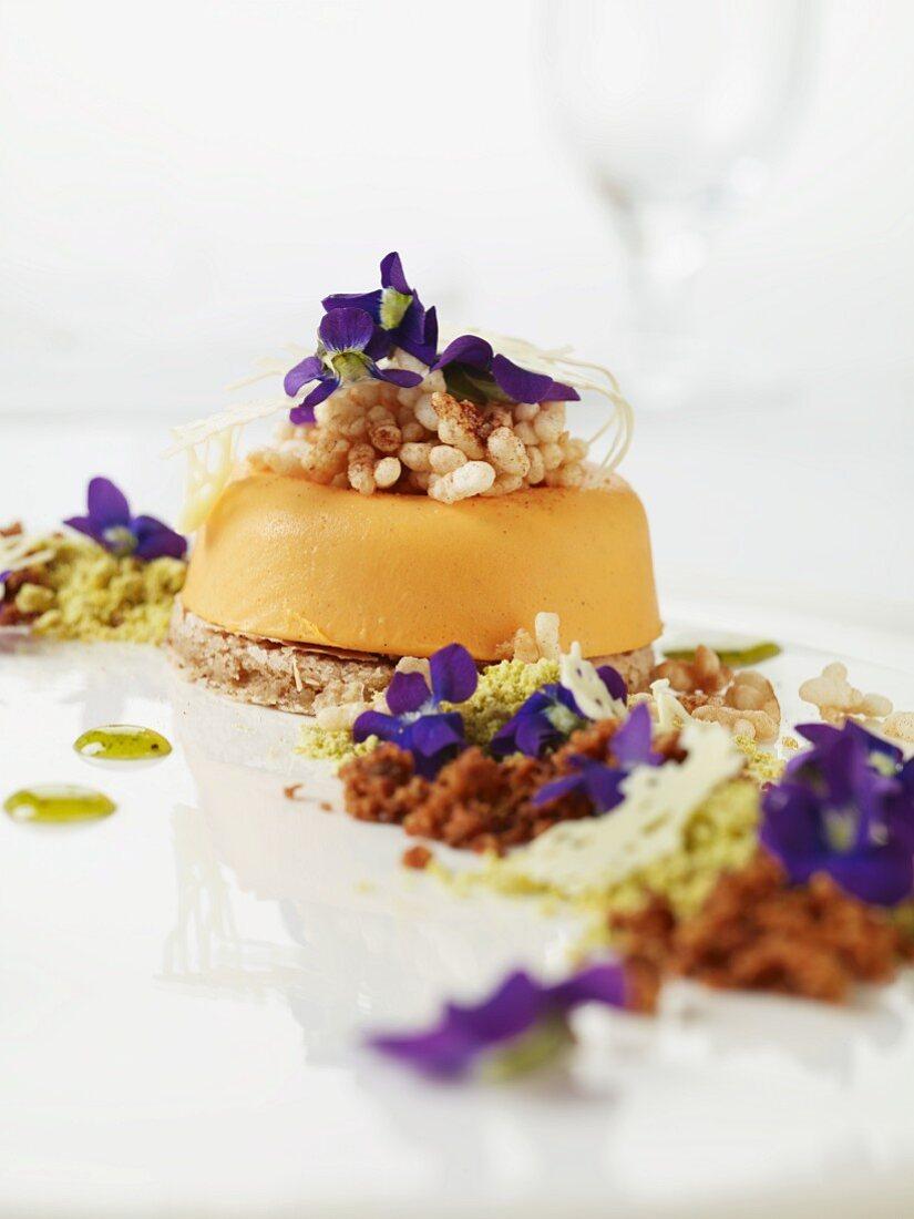 Ice cream cake with puffed rice and purple flowers