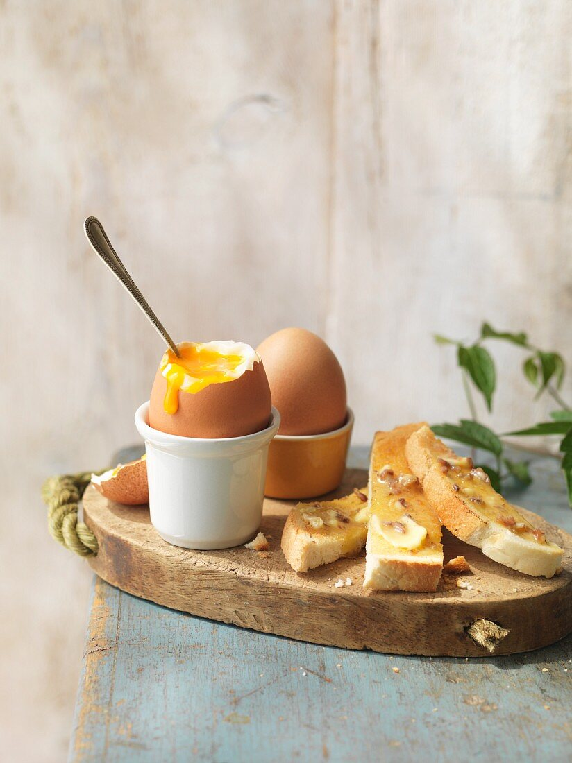 A soft-boiled egg with anchovy-butter toast