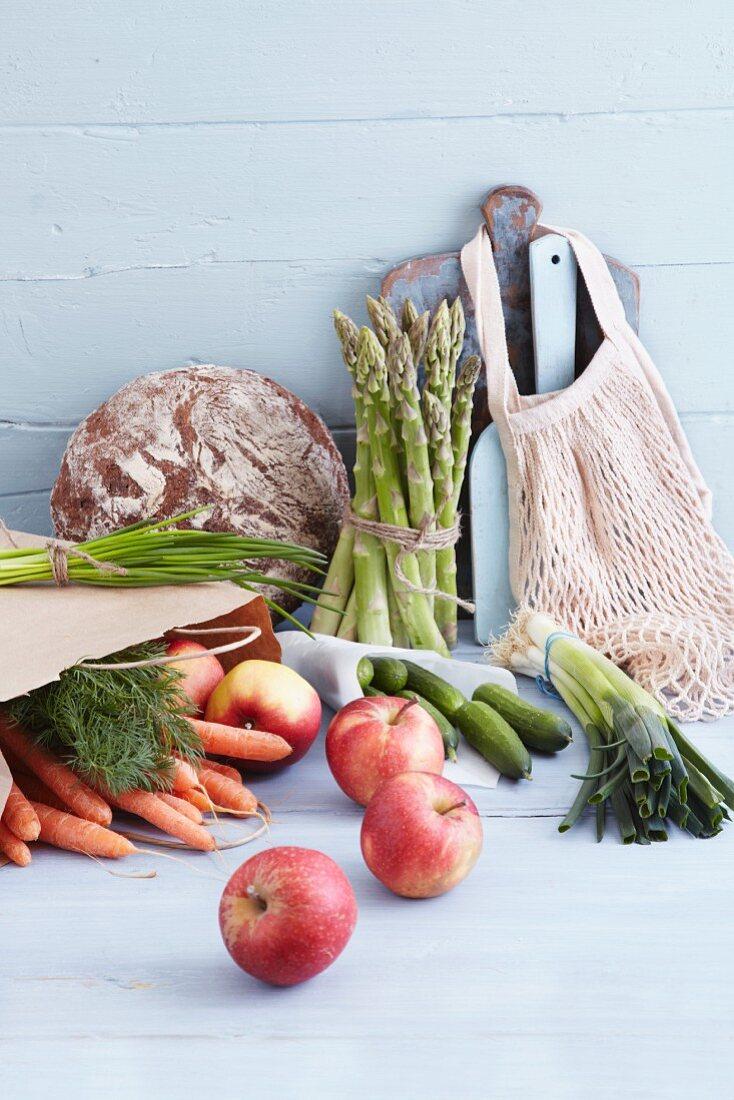 An arrangement of fruit, vegetables and bread