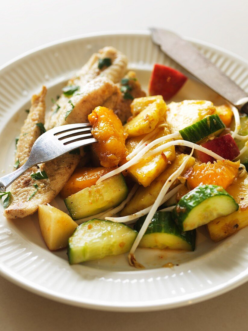 Fish fillet with Balinese vegetable salad with pineapple and bean sprouts