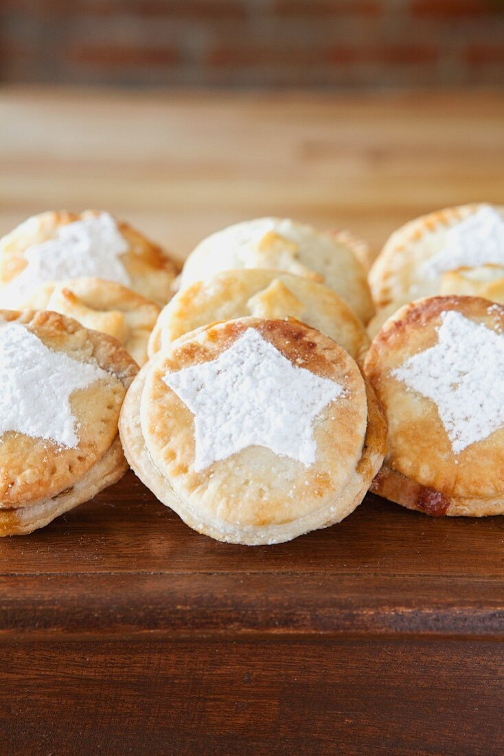 A row of mince pies on a wooden table