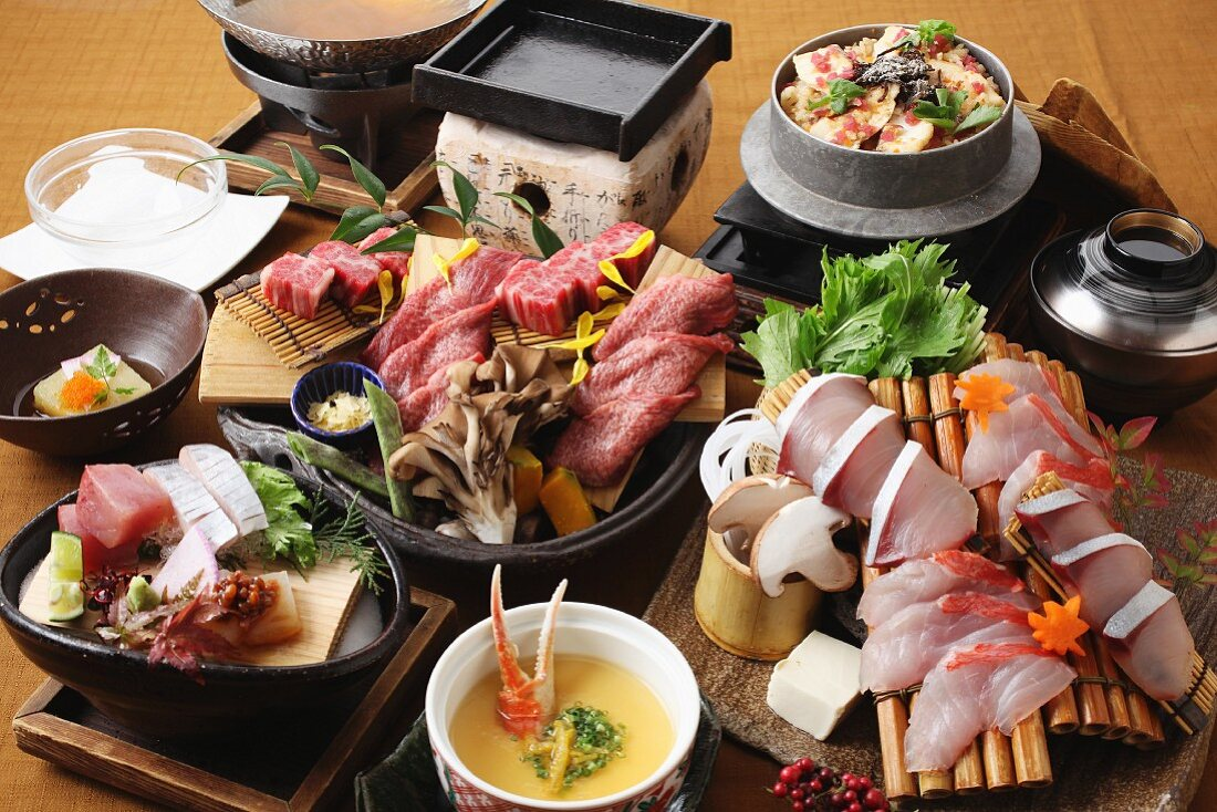 A party platter of beef, soup and sashimi (Japan)