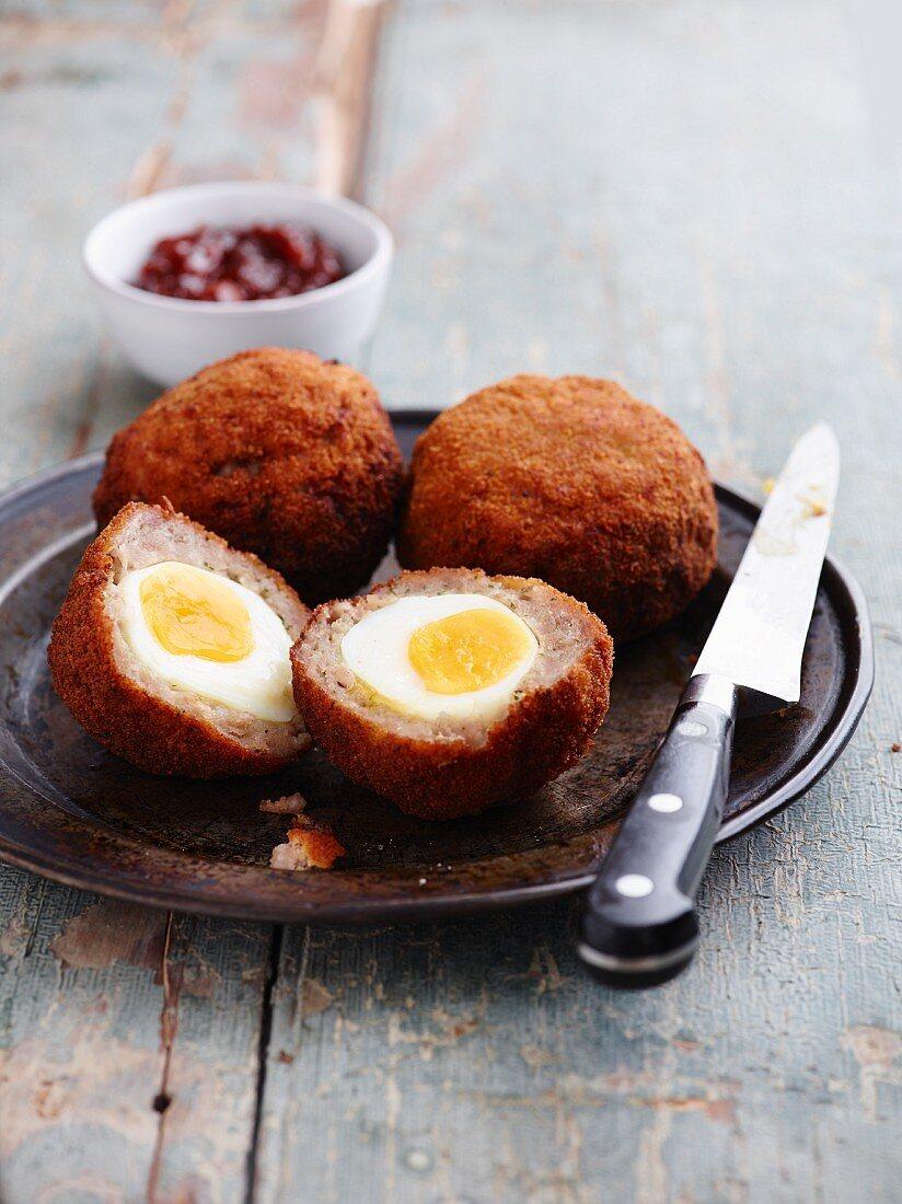 Scotch Eggs with chutney (England)