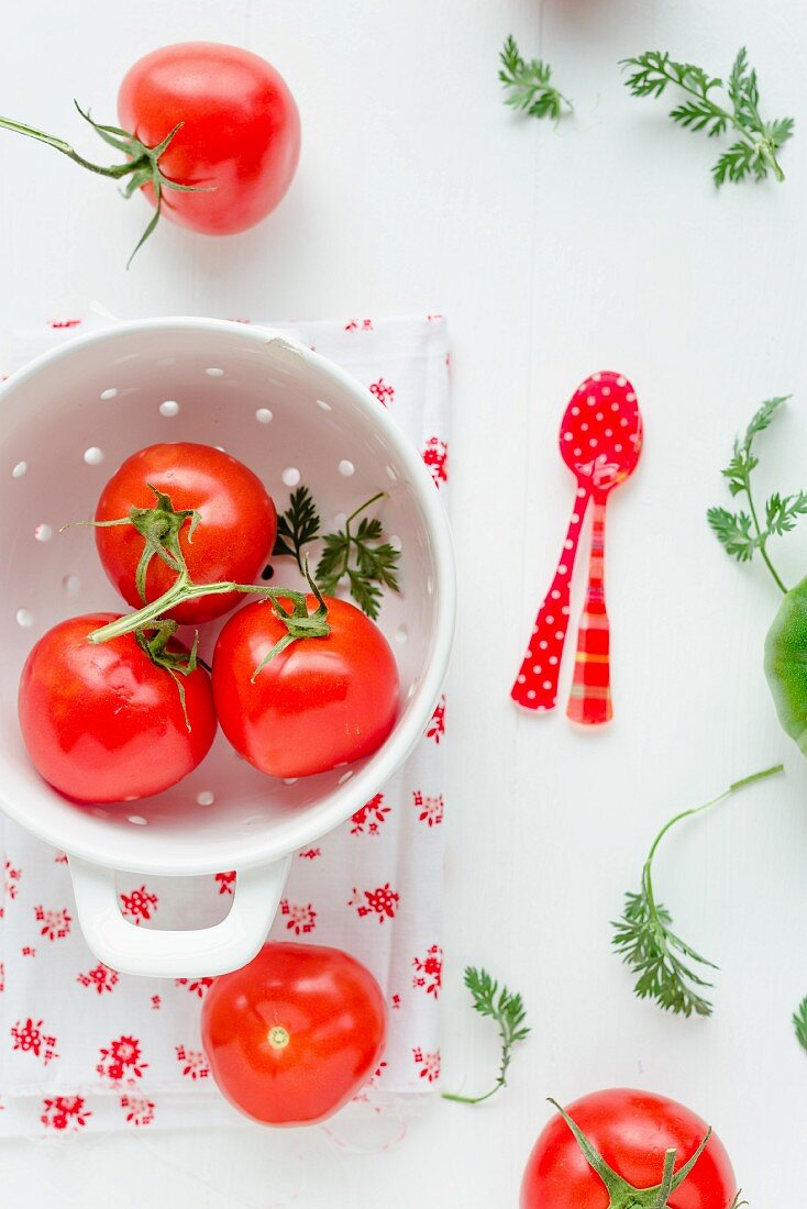Red vine tomatoes in a colander