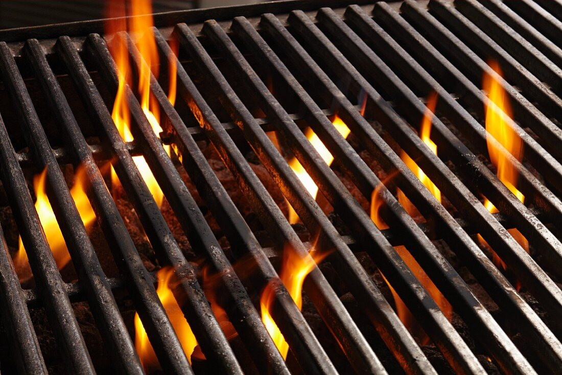 A barbecue rack over burning coals