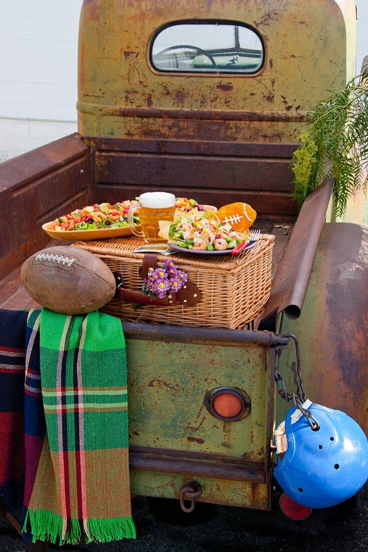 Football picnic on old vintage truck