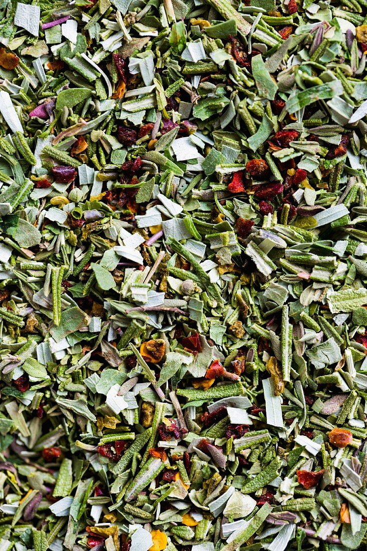 Various dried, chopped herbs (full frame)