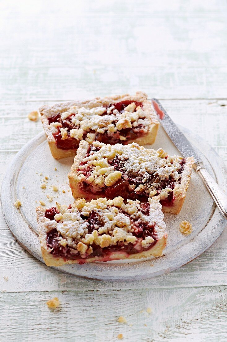 Slices of plum cake with coconut crumbles