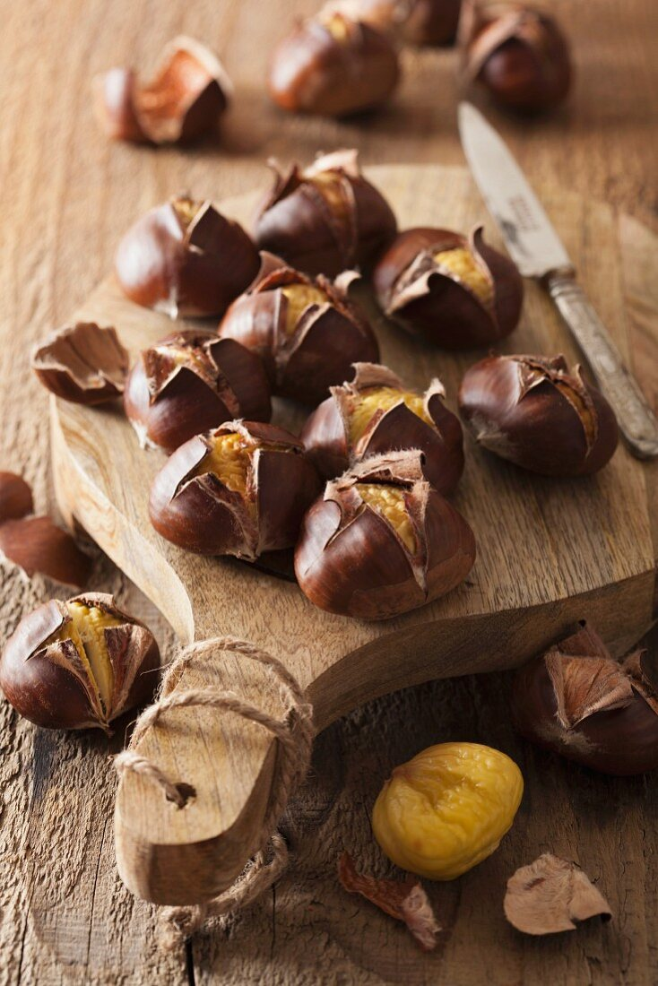 Roasted chestnuts on a chopping board