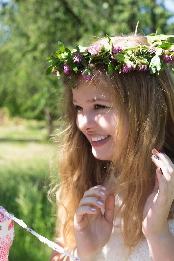Young girl wearing wreath of purple clover