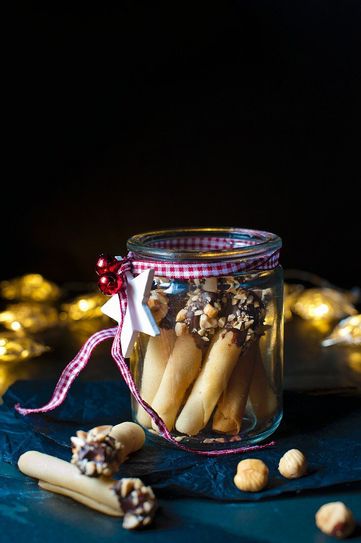 Homemade tuille biscuits with chocolate and nuts as a gift