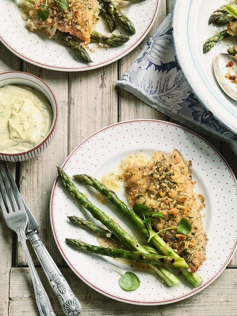 Trout with a herb coating with mustard mayonnaise and grilled asparagus